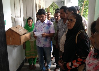 Members of the Complaint and Response Committee of the Dhulihar Union Parishad are opening the complaint box.